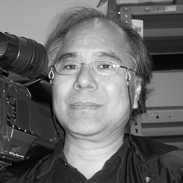 カメラマン高橋愼二氏のポートレート写真